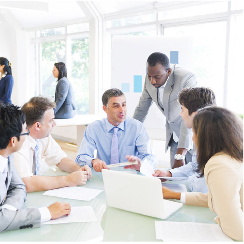 A group of people having a meeting in an open office space